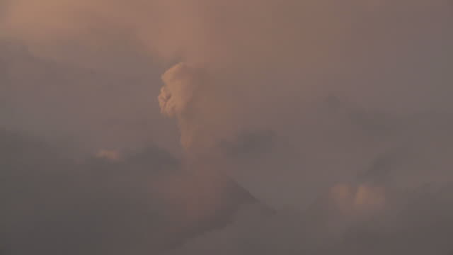 T/L video of mushroom cloud ash explosion from volcanic eruption, Philippines, Dec 2009