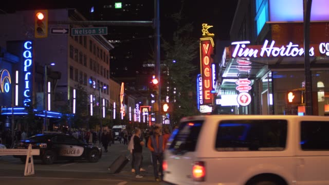 video of people partying and busy traffic at night, granville street, vancouver, british columbia, canada, north america - vancouver canada stock videos and b-roll footage