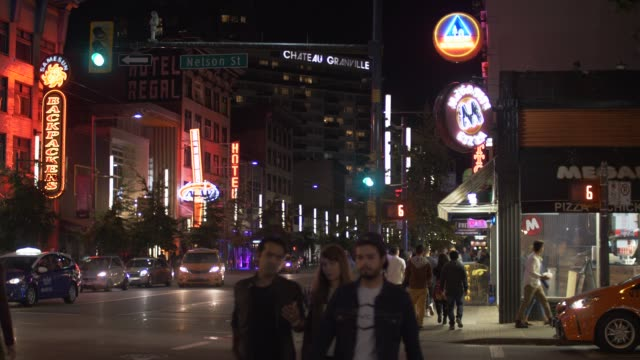 video of people partying and busy traffic at night, granville street, vancouver, british columbia, canada, north america - vancouver canada stock videos & royalty-free footage