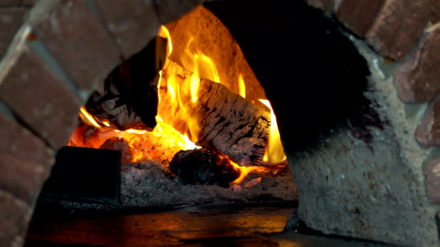 video of pizza oven in real slow motion - stone object stock videos and b-roll footage