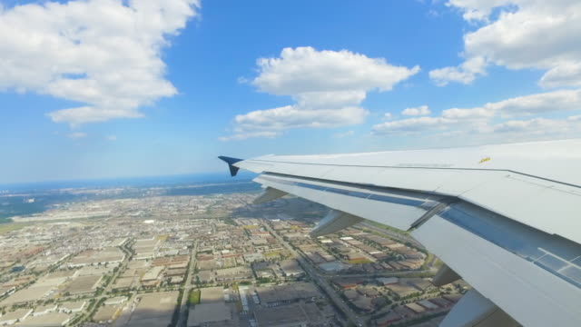 video of plane wing while flying over city - fatcamera stock videos and b-roll footage