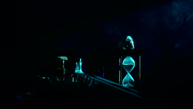 UHD Video Of Poison Bottle, Dead Insects, Hourglass, Human Skeleton and Magic Book For Halloween