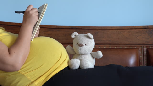 UHD Video Of Pregnant Woman Taking Notes