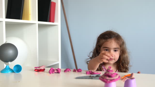 video of preschooler girl playing with child's play clay at home - selimaksan stock videos & royalty-free footage
