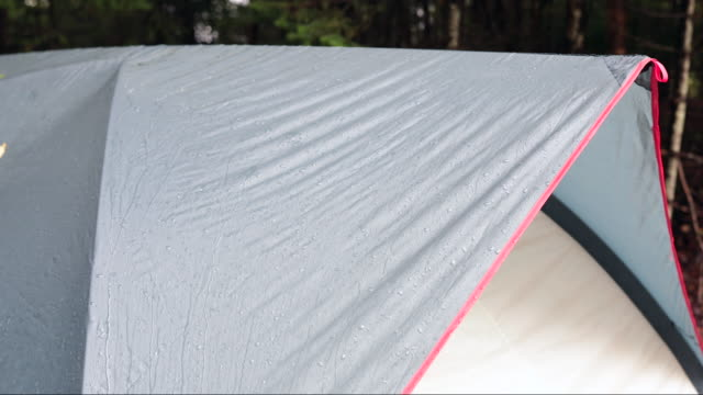 4k video of rain dripping from a tent awning and roof, camping - awning stock videos and b-roll footage