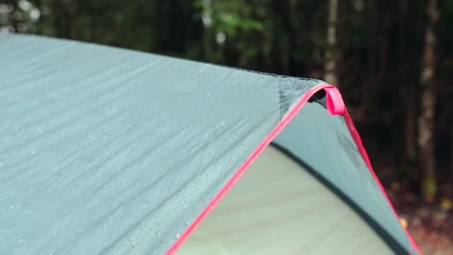 4k video of rain dripping from a tent awning and roof, camping - tent stock videos & royalty-free footage