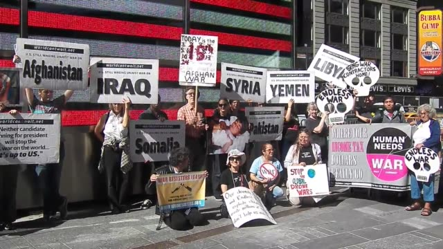 video of rally which took place in time square new york city to mark the us war in afghanistan on october 7th 2001 the us launched a military strike... - poster stock videos & royalty-free footage