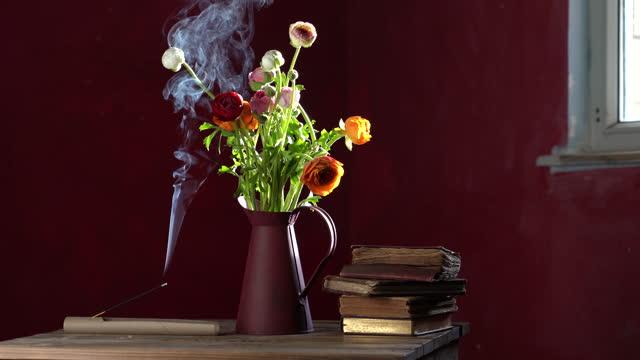 video of ranunculus flowers in vase next to incense stick - ranunculus stock videos & royalty-free footage