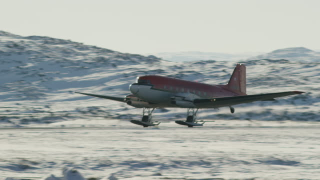 video of red airplane taking off in the snow - anchorage alaska stock videos & royalty-free footage