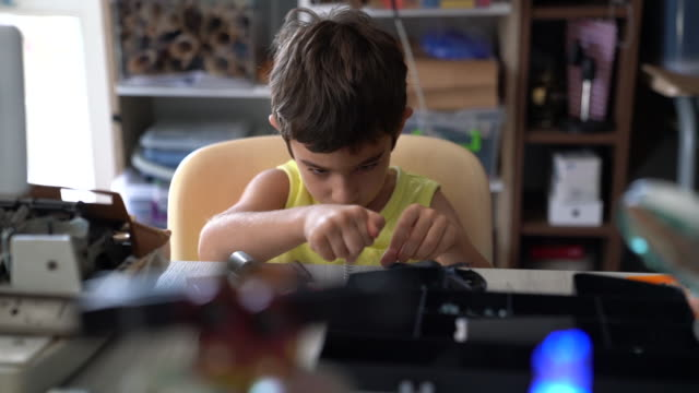 hd video of schoolboy working on robotics - selimaksan stock videos & royalty-free footage
