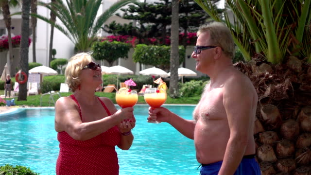 Video of senior couple drinking cocktails in real slow motion