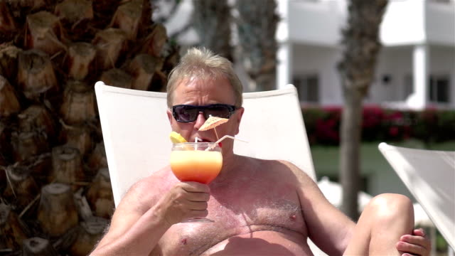 video of senior man drinking cocktail in real slow motion - sunbathing stock videos and b-roll footage