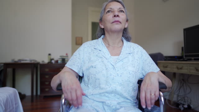 video of senior woman in wheelchair - paraplegic stock videos & royalty-free footage