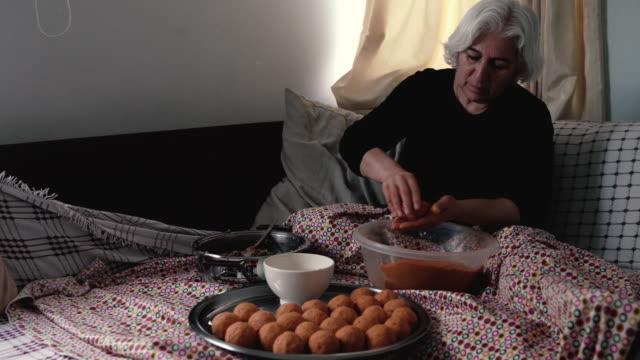 uhd video of senior woman preparing stuffed meatballs - meatballs stock videos & royalty-free footage