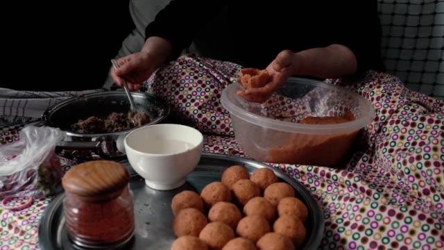 uhd video of senior woman preparing stuffed meatballs - stuffed stock videos & royalty-free footage