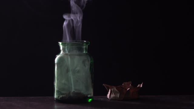 4k video of smoke coming out of green poison bottle in dark - selimaksan stock videos & royalty-free footage