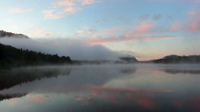 4k video of sunrise at monroe lake, tremblant, quebec, canada - north america stock videos & royalty-free footage