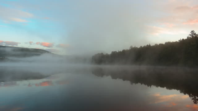 4k video of sunrise at monroe lake, tremblant, quebec, canada - 4k resolution stock videos & royalty-free footage