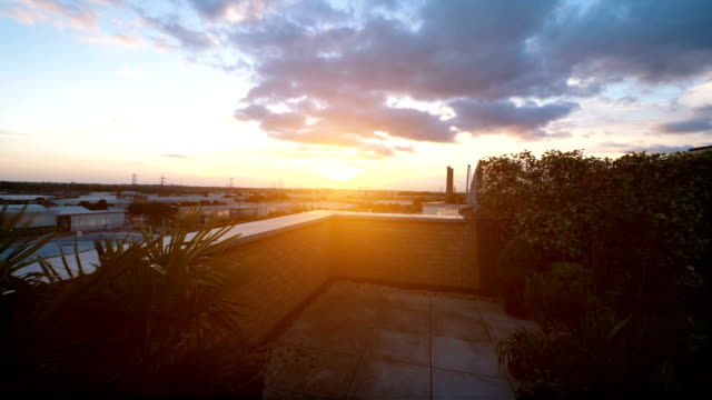 video of sunset on the roof in 4k slow motion - patio stock videos & royalty-free footage