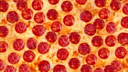A video of the background pepperoni pizza. Footage.