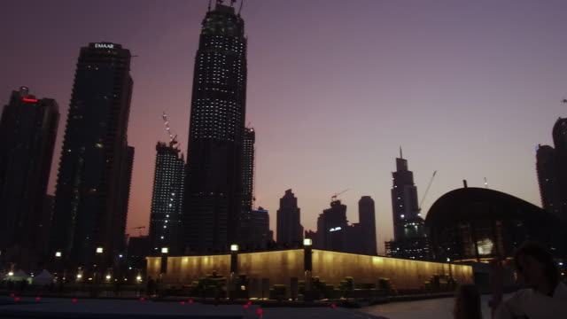 video of the dubai fountain in dubai mall with family watching, evening - illuminated stock videos & royalty-free footage