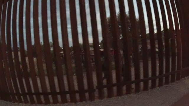 video of the international border wall dividing el paso and ciudad juarez, mexico at sunset - international border stock videos & royalty-free footage