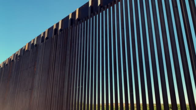 4k video of the international wall between mexico and the united states in new mexico where the wall is under construction. - fence stock videos & royalty-free footage
