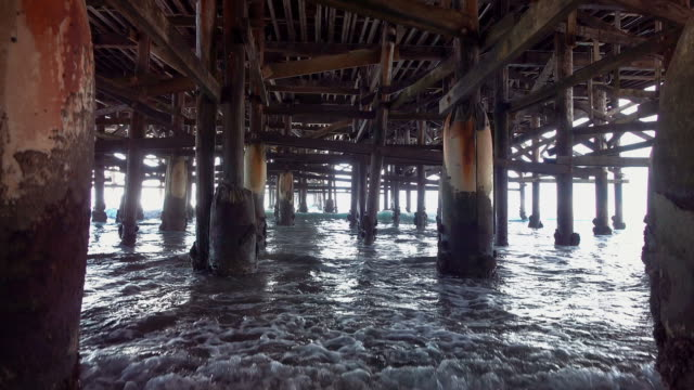 video of walking under pier in real slow motion - molo video stock e b–roll