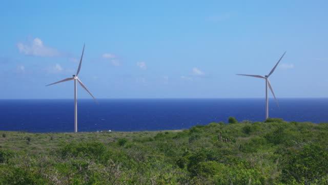 4k video of wind turbin along caribbean sea, curacao - turbine stock videos & royalty-free footage