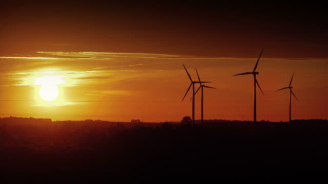 Video of windmills at the sunset in 4K