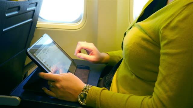 Video of woman using digital tablet in 4K