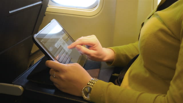 video of woman using tablet in 4k - paper scroll stock videos and b-roll footage