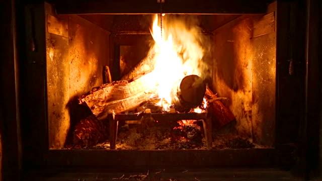 Video of wood on fire inside a fireplace HD