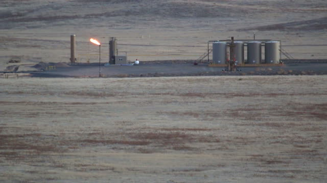 hd video oil well pad from pawnee national grasslands colorado - fracking stock videos and b-roll footage