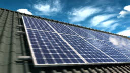 Video panning of solar panels modules on roof on a clear sunny day