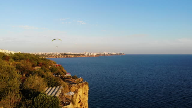 4k video, paragliding in antalya - ozgurdonmaz stock videos and b-roll footage