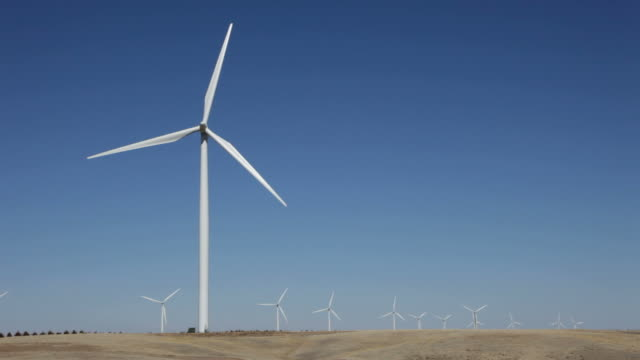 hd video peetz wind farm turbines northeastern colorado - general electric stock videos and b-roll footage