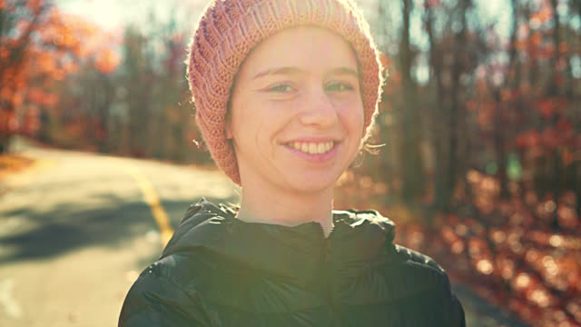 video portrait of 16-years-old pretty girl walking outdoor at fall - video portrait stock videos & royalty-free footage