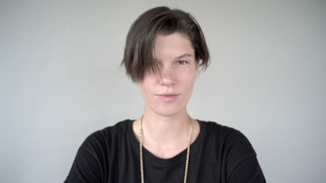a video portrait of a gender neutral person. - studio shot stock videos & royalty-free footage