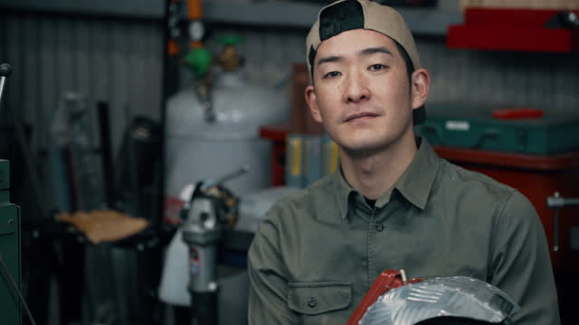 video portrait of a mid adult male removing his welding helmet - welding helmet stock videos & royalty-free footage