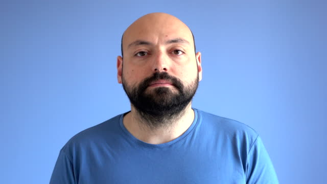 UHD Video Portrait Of Adult Man With Blank Expression