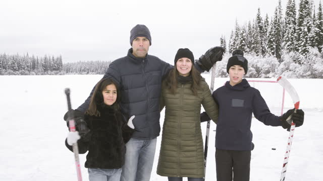 video portrait of family ice skating outdoors - video portrait stock videos & royalty-free footage
