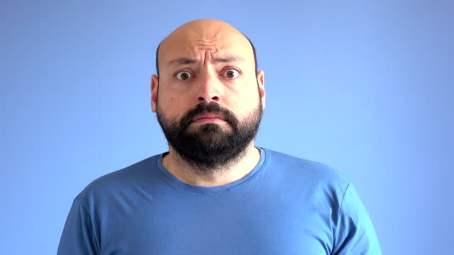 UHD Video Portrait Of Frightened Adult Man