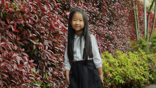 video portrait of japanese little girl in school uniform - japanese school uniform stock videos & royalty-free footage