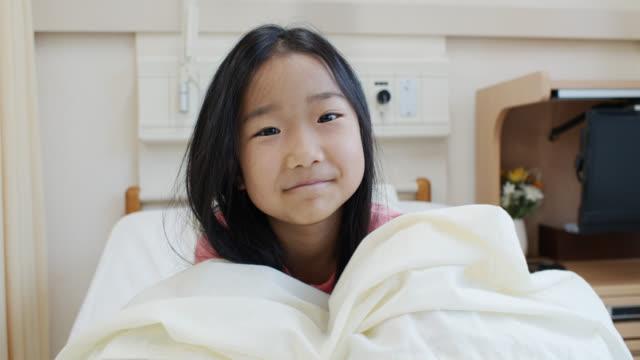 video portrait of little girl in children's hospital bed - children's hospital stock videos & royalty-free footage