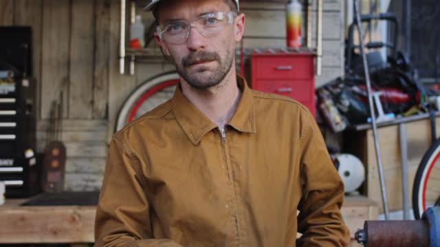 video portrait of metal worker - video portrait stock videos & royalty-free footage