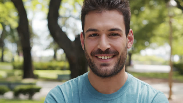 video portrait von smiling 20-something in sportswear - one young man only stock-videos und b-roll-filmmaterial