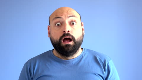 uhd video portrait of surprised adult man - facial expression stock videos & royalty-free footage
