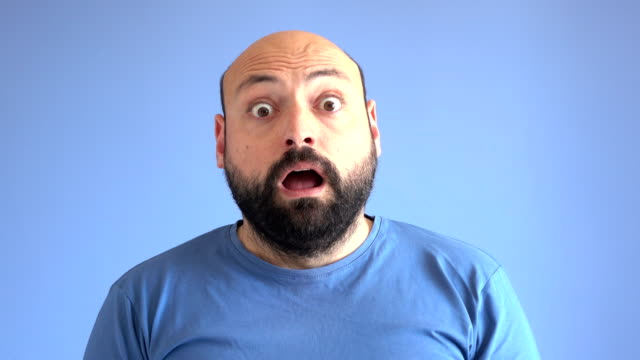 uhd video portrait of surprised adult man - horror stock videos & royalty-free footage