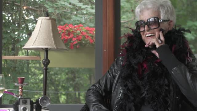 video portrait senior woman alone in gazebo - human age stock videos & royalty-free footage